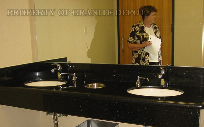 "Black Galagy granite, 9"" apron, 6"" splash-a rest room in a bank building"