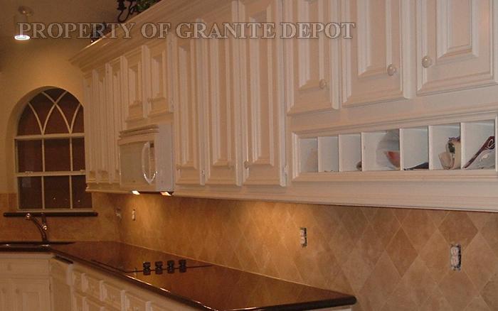 White Cabinet, Black pearl granite, and travertine back splash
